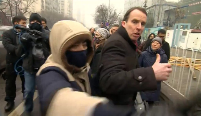 The BBC's John Sudworth manhandled outside Pu Zhiqiang trial. (Photo courtesy: BBC)