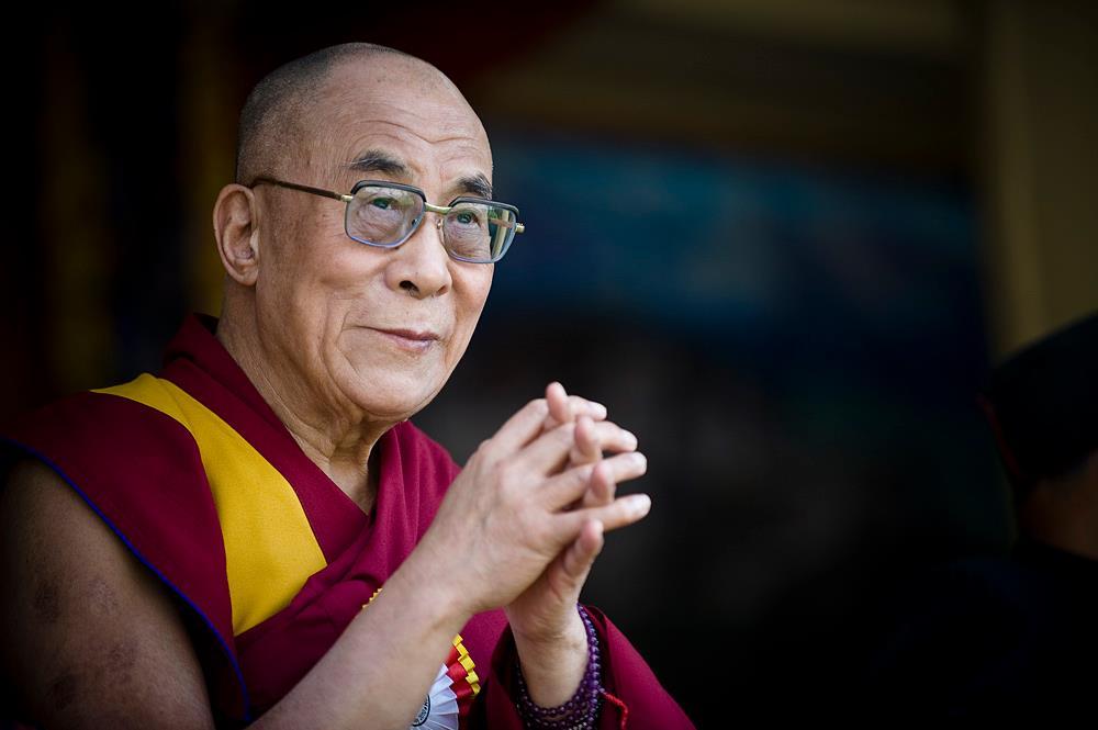 China equates Dalai Lama with Saddam Hussein, suggests Tibetans revere its leaders' pics instead