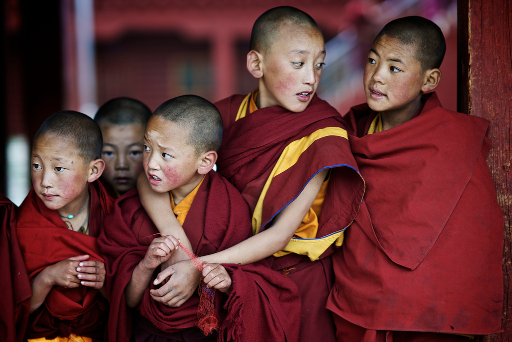 Tibetan child monk in monestry, Litang, Kham, TIbet. (Photo courtesy: Alex Saurel)