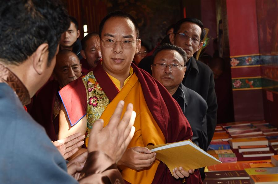 11th Panchen Lama appointed by China listens to introductions from leaders of the Tibet College of Buddhism.The 11th Panchen Lama, vice president of the Chinese Buddhist Association, visited the Tibet College of Buddhism in Lhasa, on November 29, 2015. (Photo courtesy: eng.tibet.cn)