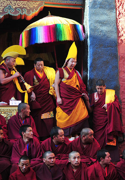 China's chosen 11th Panchen Lama (center), attends a ceremony marking the 20th anniversary of his ordination at the Tashilhunpo Monastery in Shigatse, Tibet on Tuesday. (Photo courtesy/China Daily)