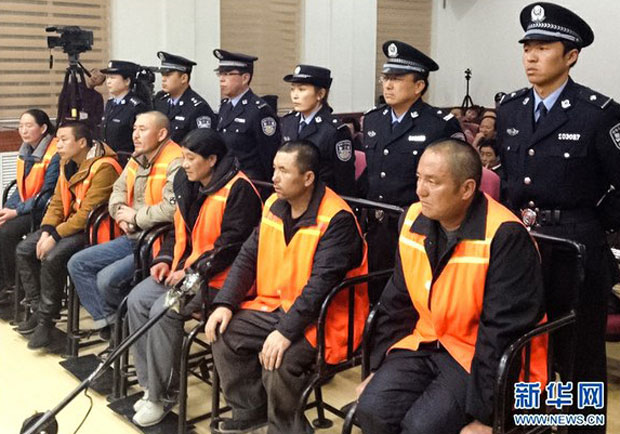 Yangmo Kyi (far left) and other defendants hear their sentences read in a Gansu court in an undated photo. (Photo courtesy: Xinhua)