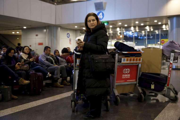French journalist Ursula Gauthier, a reporter in China for the French news magazine L'Obs, checks her cellphone as she waits at Bejing Capital International Airport in Beijing, Thursday, Dec. 31, 2015. Gauthier is leaving China after being denied press credentials and facing heavy criticism from the Foreign Ministry and state media over her reporting, becoming be the first foreign journalist forced to leave China since 2012, when American Melissa Chan, then working for Al Jazeera in Beijing, was expelled. (Photo courtesy/Reuters)