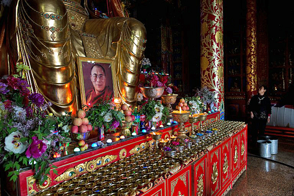 A portrait of Tibetan spiritual leader the Dalai Lama sits on an alter inside Longwu monastery in Tongren, northwestern Qinghai province, May 16, 2013. (Photo courtesy: AFP)