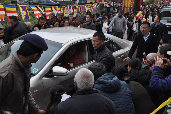 His Holiness the Dalai Lama arrives in Tsuklakhang amid hundreds of devotees offering him a traditional welcome on 13 March 2016. (Photo courtesy: tibet.net)