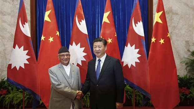 Chinese President Xi Jinping, right, shakes hands with Nepal Prime Minister Khadga Prasad Oli inside the Great Hall of the People in Beijing, China. (Photo courtesy: AP)