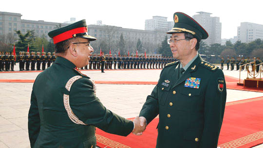 General Fang Fenghui (R), member of China's Central Military Commission (CMC) and chief of Joint Staff Department of the CMC, shakes hands with Nepal's Chief of Army Staff General Rajendra Chhetri at a welcoming ceremony held in Beijing on March 28, 2016. (Photo courtesy: english.chinamil.com.cn/)