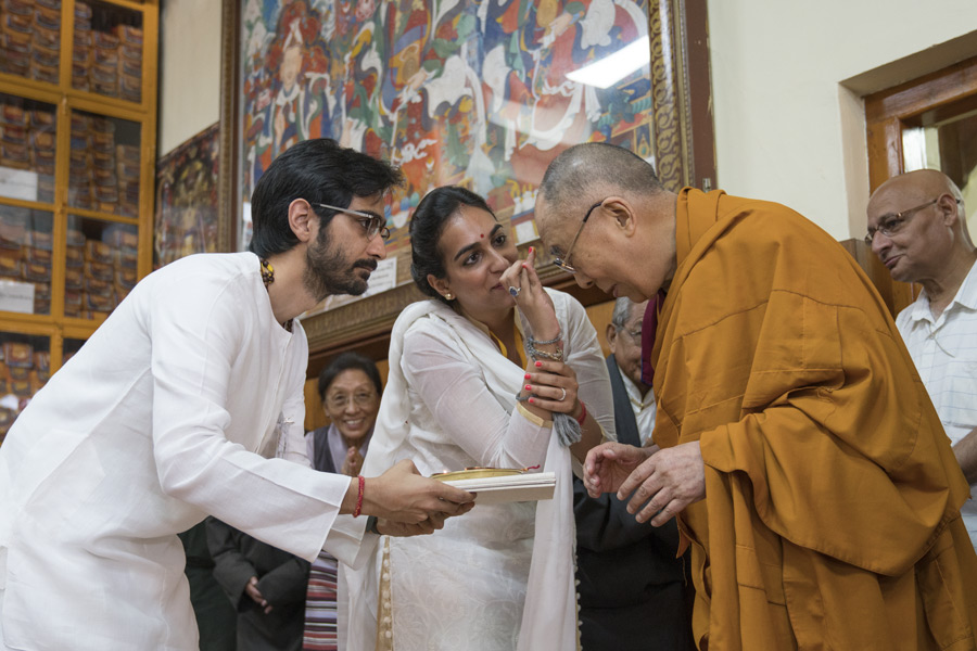 His Holiness the Dalai Lama receiving traditional Indian offerings on his arrival at the Main Tibetan Temple at the start of a three day teaching for Indian Buddhists in Dharamsala, HP, India on June 7, 2016. (Photo courtesy/Tenzin Choejor/OHHDL)