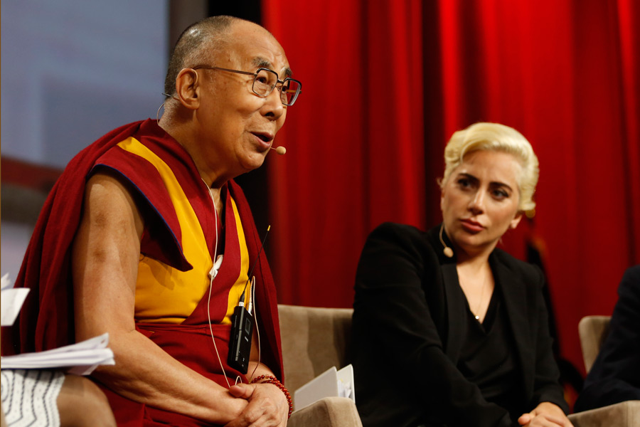 Lady Gaga looking on as His Holiness the Dalai Lama answers questions from the audience at the United States Conference of Mayors in Indianapolis, IN, USA on June 26, 2016. (Photo courtesy/Chris Bergin)