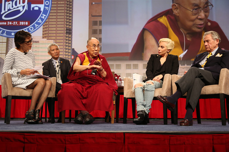 The panel of Ann Curry, His Holiness the Dalai Lama, Lady Gaga and Phillip Anschutz answering questions from the audience at the United States Conference of Mayors in Indianapolis, IN, USA on June 26, 2016. (Photo courtesy/Chris Bergin)