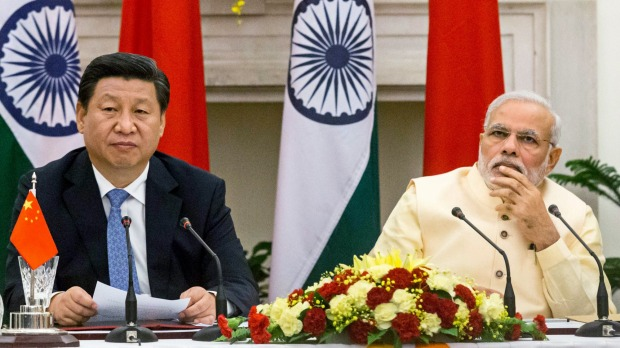 Narendra Modi, India's prime minister, right, and Xi Jinping, China's president. (Photo courtesy: Bloomberg)