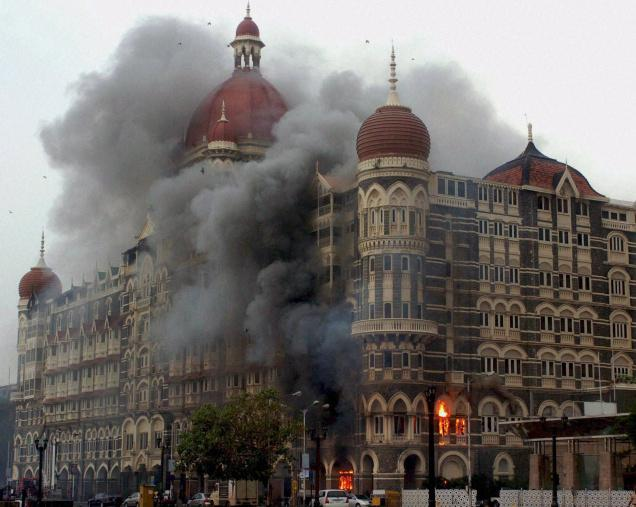 "Smoke billowing out of the Taj Hotel in south Mumbai during security personnel's ""Operation Cyclone"" following the 26/11 terror attacks in 2008. (Photo courtesy: PTI)"