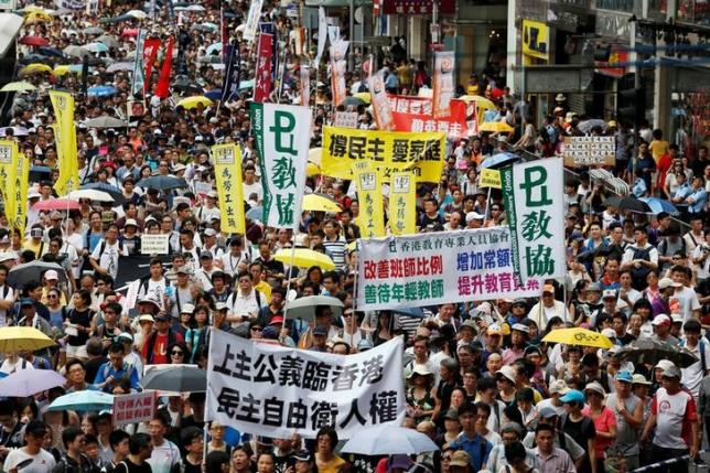 Pro-democracy protesters take part in a march on the day marking the 19th anniversary of Hong Kong's handover to Chinese sovereignty from British rule, in Hong Kong July 1, 2016.  (Photo courtesy: REUTERS/Bobby Yip)