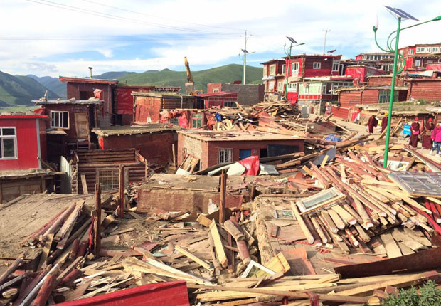 Larung Gar Buddhist Academy in Serta. Destroyed structures are shown at Larung Gar as demolition work begins, July 20, 2016. (Photo courtesy: RFA)