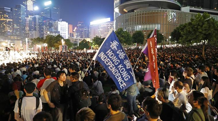 "Protesters rally outside the Hong Kong government headquarters, Friday, Aug. 5, 2016 as they demand Hong Kong Independence. Amid a dispute over candidates excluded on political grounds, Hong Kong's government on Friday posted the names of those approved to run in the territory's most contentious Legislative Council elections since reverting to Chinese rule almost two decades ago. The placard reads ""Punish rioters severely, pay back in prison"". (Photo courtesy/AP/Kin Cheung)"