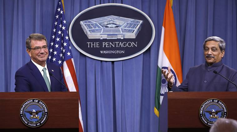 Defence Secretary Ash Carter listens at left as Indian Defence Minister Manohar Parrikar speaks during their joint news conference at the Pentagon. (Photo courtesy: AP Photo|Jacquelyn Martin)