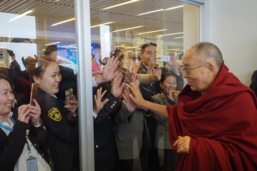 His Holiness the Dalai Lama greeting well-wishers as he prepares to depart for Japan from Chhanghis Khaan International Airport in Ulaanbaatar, Mongolia on November 23, 2016. Photo/Tenzin Taklha/OHHD