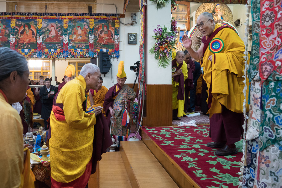 His Holiness the Dalai Lama greeting senior monks and members of the Phenpo and Pemakoe Tibetan community, organizers of the Long Life Offering Ceremony for His Holiness at the Main Tibetan Temple in Dharamsala, HP, India on November 2, 2016. (Photo courtesy/Tenzin Choejor/OHHDL)