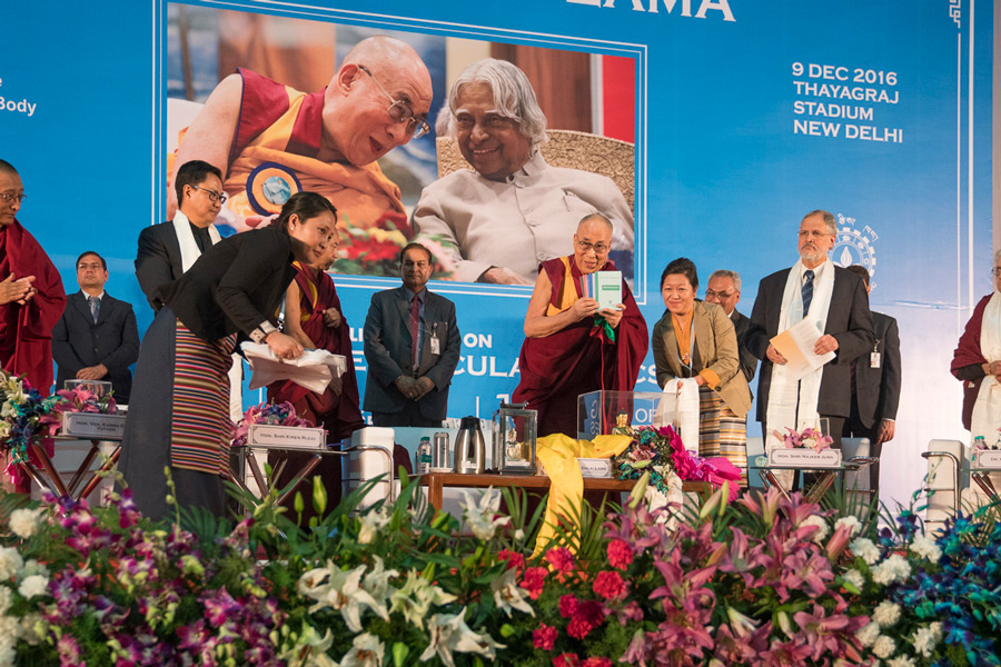 His Holiness the Dalai Lama releasing a new book from the Tibetan Medical and Astrological Institute before his talk in New Delhi, India on December 9, 2016. (Photo courtesy/Tenzin Choejor/OHHDL