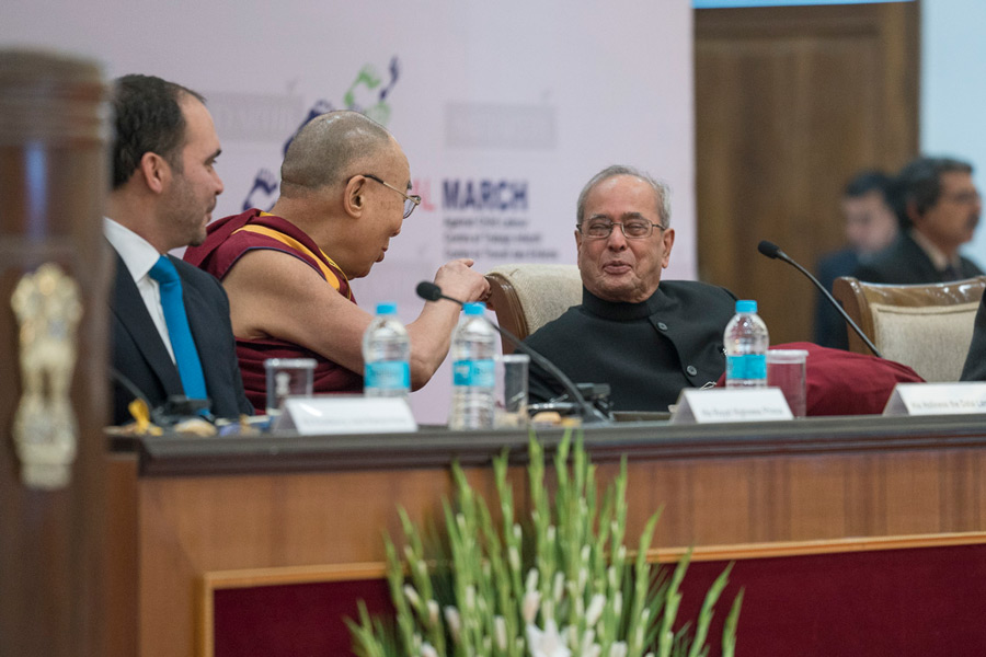 His Holiness the Dalai Lama talking with the President of India Pranab Mukherjee before the opening session of the Laureates & Leaders Summit in New Delhi, India on December 10, 2016. (Photo courtesy/Tenzin Choejor/OHHDL)