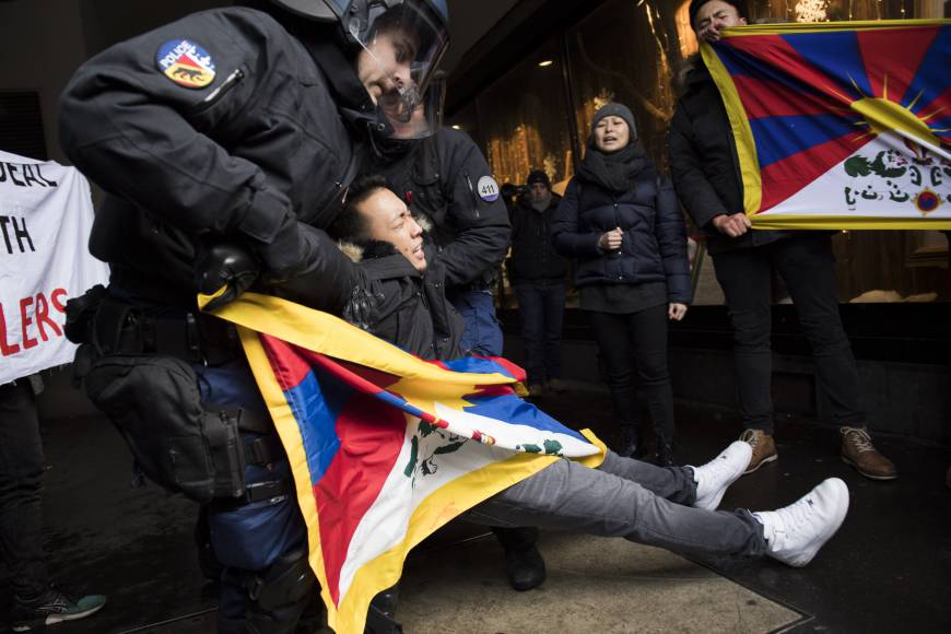People protest for a free Tibet and against the arrival of China's President Xi Jinping in Bern, Switzerland, on Sunday. | (Photo courtesy: ANTHONY ANEX / KEYSTONE VIA AP)