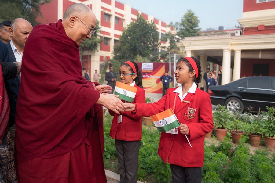 His Holiness the Dalai lama greeting students on his arrival at the Convent of Jesus and Mary in New Delhi, India on February 6, 2017. (Photo courtesy/Tenzin Choejor/OHHDL)