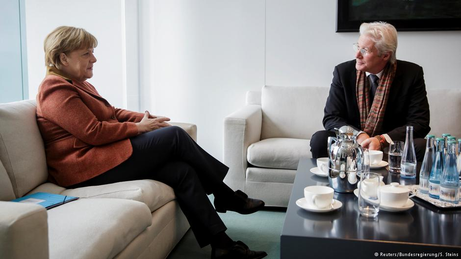 Richard Gere discusses Tibet situation with German Chancellor Angela Merkel. (Photo courtesy: Reuters)