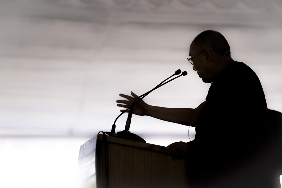 A silhouette of His Holiness the Dalai Lama during his talk on Ethics, Values and Wellbeing at the HITEX Open Arena in Hyderabad, Telangana, India on February 12, 2017. (Photo courtesy: Tenzin Choejor/OHHDL)
