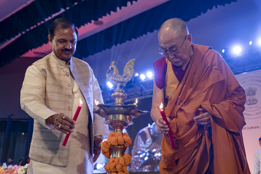 His Holiness the Dalai Lama and Union Minister of State for Culture & Tourism Dr Mahesh Sharma lighting the ceremonial lamp to inaugurate the International Buddhist Conference in Rajgir, Bihar, India on March 17, 2017. (Photo courtesy: Tenzin Choejor/OHHDL)