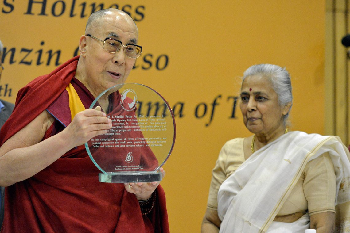 His Holiness the Dalai Lama Accepting the Professor ML Sondhi Prize for International Politics 2016 at India International Centre. (Photo courtesy: Jeremy Russell/OHHDL)