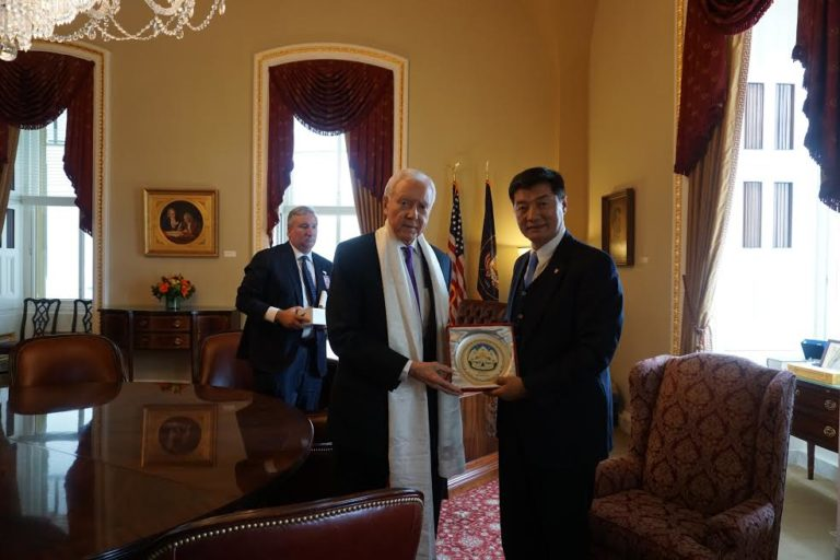 Tibetan Sikyong Dr. Lobsang Sangay presenting Kashag's Souvenir to Senator Orrin Hatch. (Photo courtesy: tibet.net)