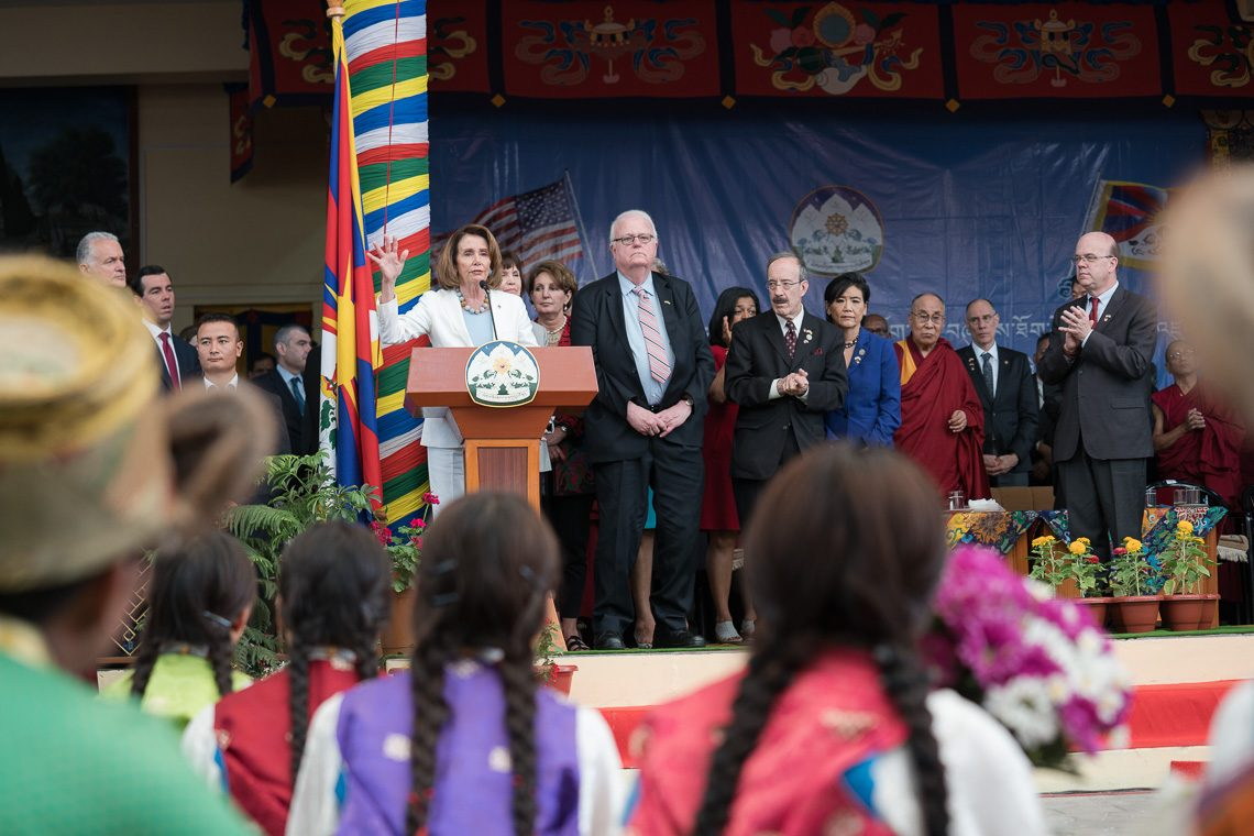 Minority Leader Nancy Pelosi, speaking at a public felicitation held for the delegation of eight House of Representatives members. Thousands of people attended the May 10 event, which was held on the Tsuglakhang courtyard, with the presence of the Dalai Lama. (Photo courtesy: T. Choejor/OHHDL)
