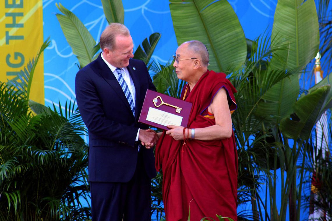 Mayor of San Diego Kevin Faulconer presenting the Dalai Lama the key to the city at the start of his public talk at UC San Diego, California on June 16, 2017. (Photo courtesy: UCSD)