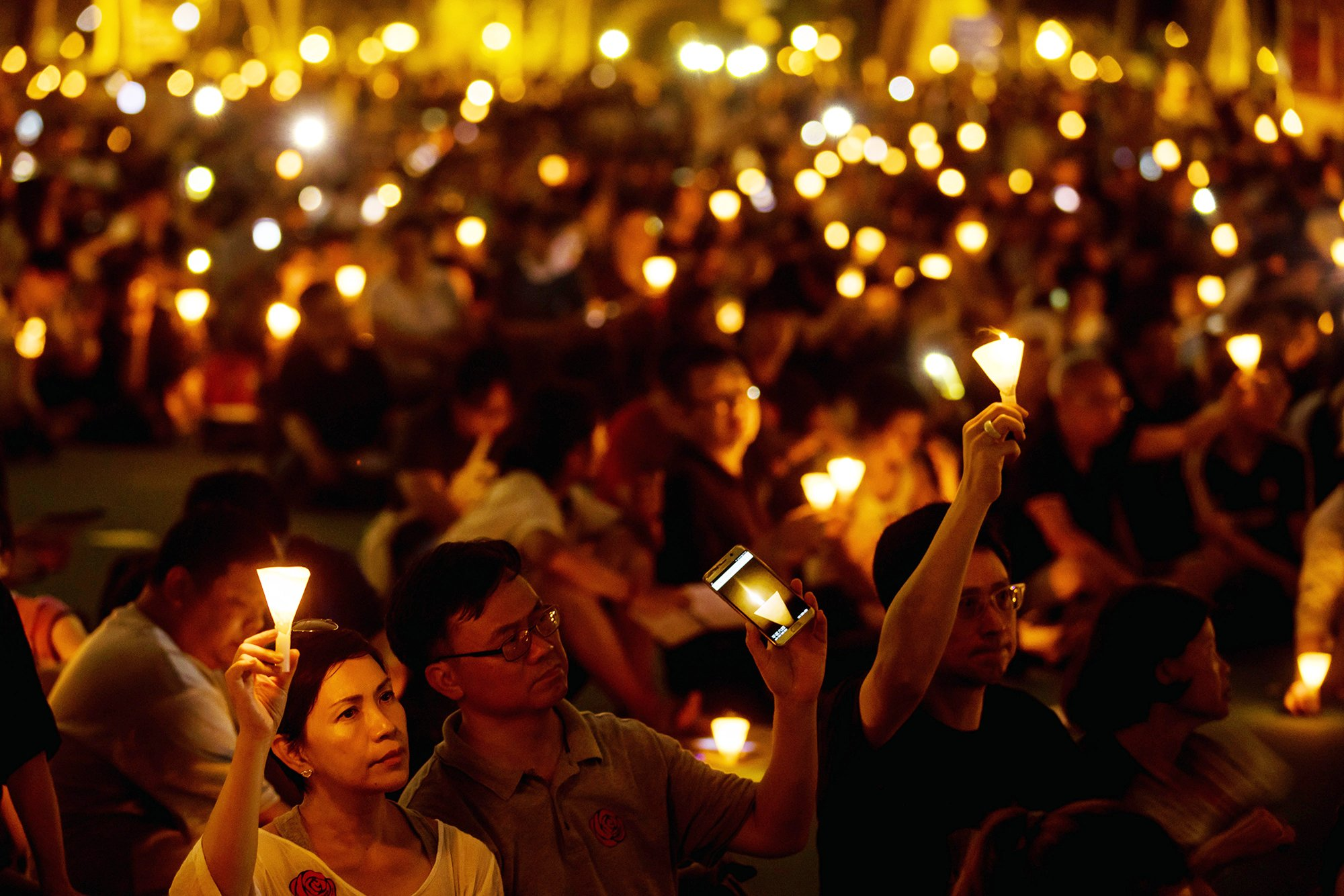 Demonstrators attend a candlelight vigil at Victoria Park in Hong Kong, on June 4, 2017.  (Photo courtesy: Time Magazine)