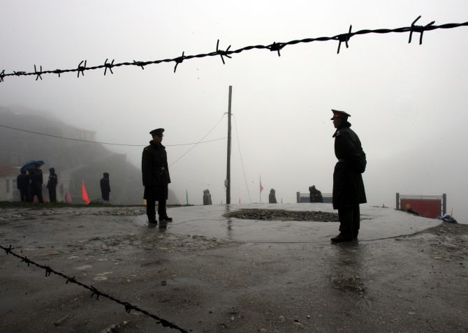 Chinese soldiers guard the Nathu La mountain pass near its border with India. (Photo courtesy: Reuters)