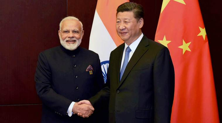Prime Minister Narendra Modi and President Xi Jinping on the sidelines of the SCO Summit in Astana, Kazakhstan. (Photo courtesy: PTI)