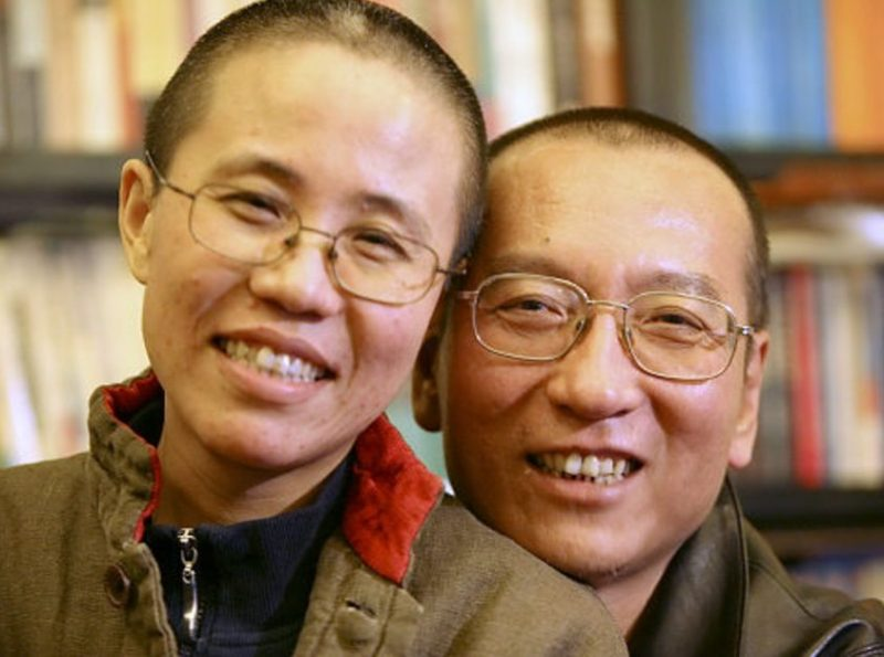 China says deceased Noble Peace laureate's widow is 'free', but she and family remain unreachable