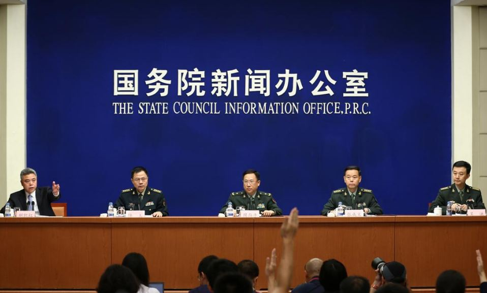 China's Defence Ministry spokesman Wuqian (R) and Central Military Commission officers including Senior Colonel Lu Yu (2nd L), Zhang Chengwen (2nd R) and Major General Zhou Shangping (center), attend a news conference in Beijing, China July 24, 2017. (Photo courtesy: REUTERS)