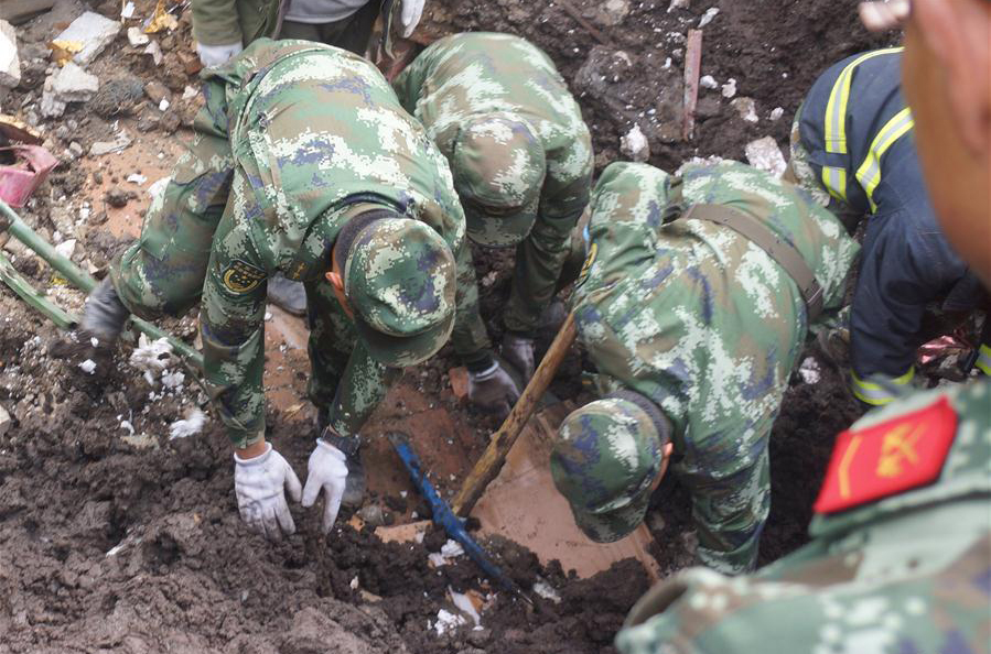 Nine people were buried in the landslide which occurred early Wednesday morning. (Photo courtesy: Xinhua/Gazang Redan)