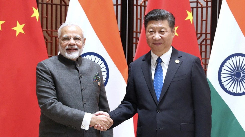 Indian Prime Minister Narendra Modi and Chinese President Xi Jinping have agreed on Sep 5 that keeping peace on their border was necessary to further deepen their bilateral ties.  (Photo courtesy: Xinhua)