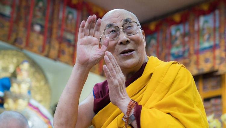 His Holiness the Dalai Lama waving at the audience on his arrival at the Tsuglagkhang on the second day of his teachings in Dharamsala, HP, India on October 4, 2017. (Photo courtesy: T Choejor/OHHDL)