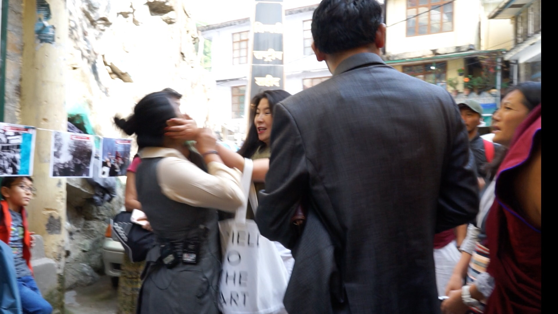 Wen Qi Zhu, a Chinese American woman seen grabbing Lhagyari Namgyal Dolkar by her head. (Photo courtesy: phayul.com)