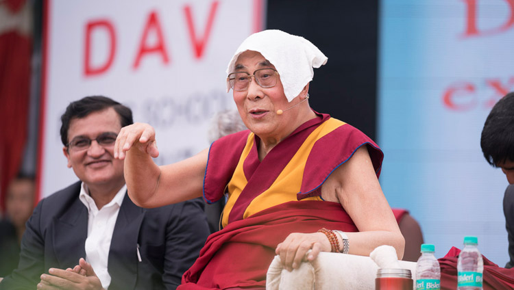 His Holiness the Dalai Lama speaking at the launch of a curriculum prepared by Ayurgyan Nyas introducing training in Universal Ethics at CJ DAV Public School in Meerut, UP, India on October 16, 2017. (Photo courtesy:  T Choejor/OHHDL)