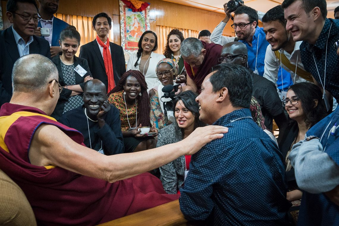 His Holiness the Dalai Lama greeting USIP youth leaders at the start of their dialogue at his residence in Dharamsala, HP, India on November 6, 2017. (Photo courtesy: T Choejor/OHHDL)