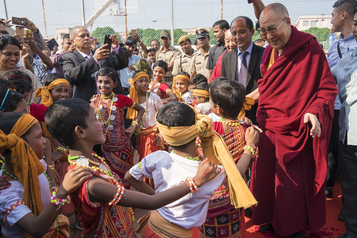 Young children in traditional dress dancing for Dalai Lama as he arrives at the KISS Humanitarian Award Cermony at Bhubaneshwar, Odisha, India on Nov 21, 2017. (Photo courtesy: T Choejor/OHHDL)