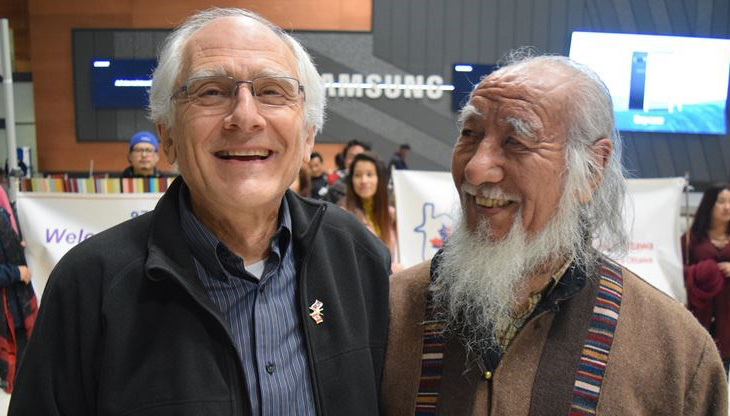 Cornelius von Baeyer, chair of the Tibetan Resettlement Project in Ottawa, (left) waits with Jurme Wangda at the Ottawa International Airport on Nov. 2 for the arrival of the last Tibetan sponsored through the project. (Photo courtesy: Erin McCracken/Metroland)