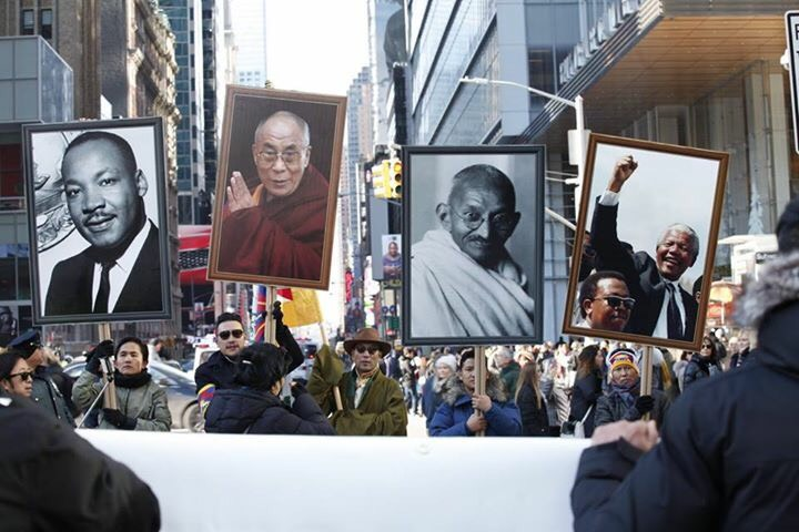 Participants of the rally holding photos of Mahatma Gandhi, Martin Luther King, Nelson Mandela and Dalai Lama at the New York City on Dec 10, 2017. (Photo courtesy/Goms Vision)