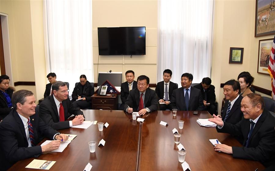 Danzeng Langjie (1st R), vice chairman of the Standing Committee of the People's Congress of China's Tibet Autonomous Region, meets with U.S. Senator Steve Daines (1st L) and Senator John Barrasso (2nd L) in Washington Dec. 5, 2017. A National People's Congress (NPC) delegation of legislators from Tibet Autonomous Region on Wednesday wrapped up its five-day visit to the United States. (Photo courtesy: Xinhua/Yin Bogu)