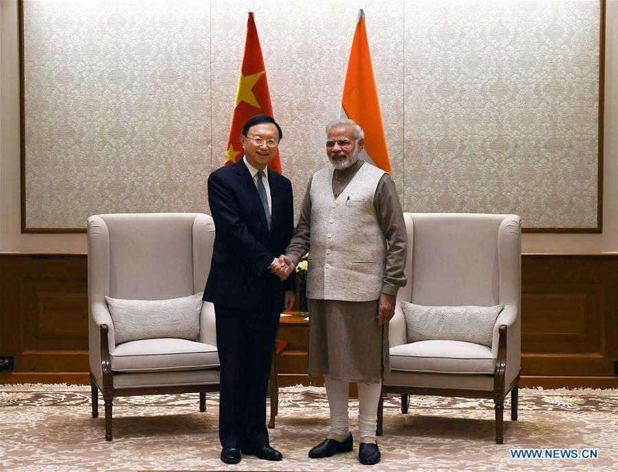 Indian Prime Minister Narendra Modi (R) meets with visiting Chinese State Councilor Yang Jiechi in New Delhi Dec. 22, 2017. (Photo courtesy: Xinhua/Zhang Naijie)