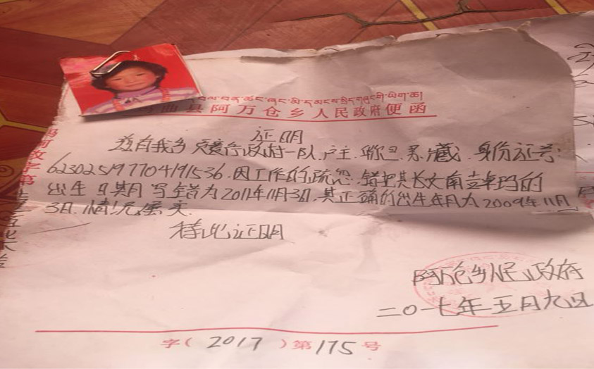 Copy of the application with Namkyi Dolma's photo submitted to township government. (Photo courtesy: TCHRD)